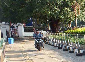 Motorcyclist on Sidewalk