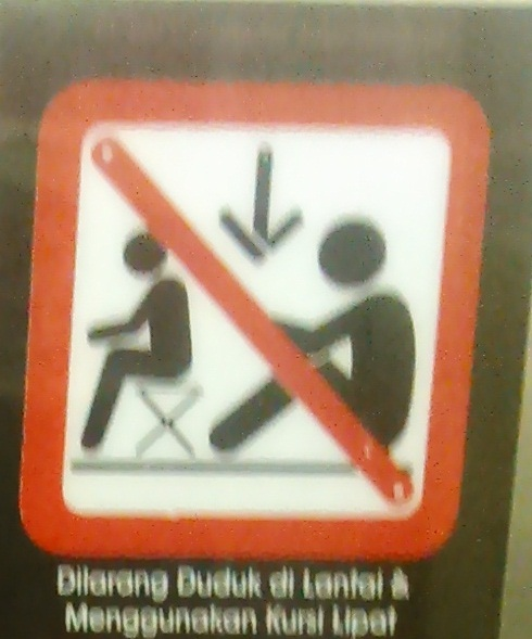 Unique signs on Indonesia Commuter Train