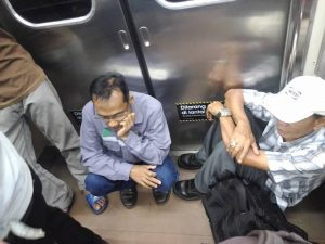 sitting on the train floor is prohibited but it doesnt mean anything for some people 2